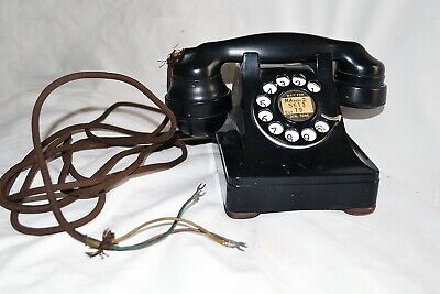 vintage Western Electric type telephone with original cloth covered wires.