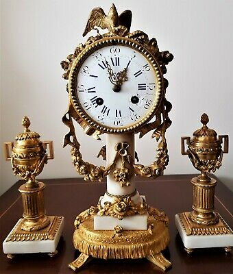 Antique French Ormolu and White Marble Clock Garniture.