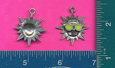 12 wholesale pewter sun with glasses pendants 4033