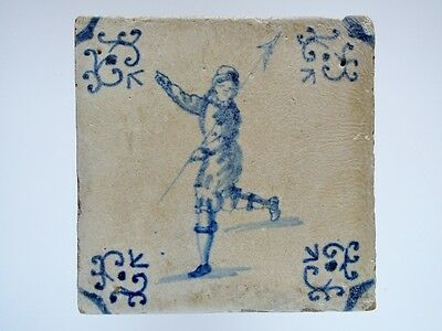 A Dutch Delft tile with a man holding a spear