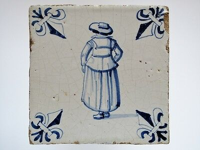A Dutch Delft tile with a standing lady with a beautifull hat.........