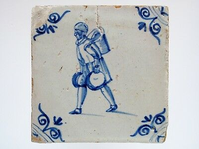 A Dutch Delft tile with a pedlar carrying many pieces......