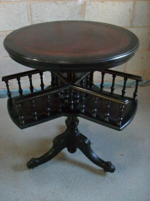 Unusual Victorian ebonised Mahogany and circular table revolving bookcase