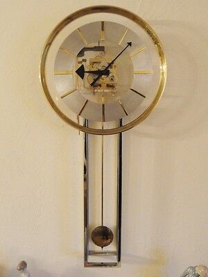 RARE 70's HOWARD MILLER LUCITE CHROME & GILT BEZEL PENDULUM CHIME WALL CLOCK