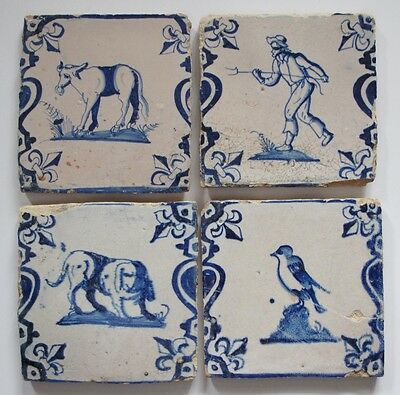 4 Antique socalled baluster Delft delftware tiles with cow farmer dog and bird..