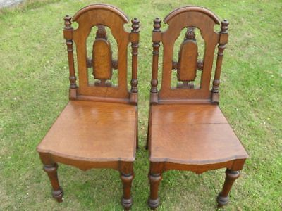 Pair of Victorian Oak Hall Chairs with Carved, Turned and Pierced Backs