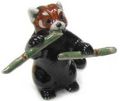 R315A - Northern Rose - Red Panda Cub standing with a bamboo stick