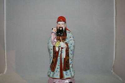 Chinese Famille-Rose Enamelled Statue Of Immortal Holding Child