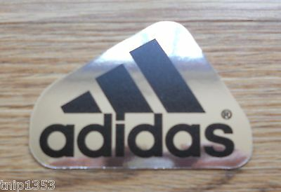 Small  Adidas  Chrome/Black  Sign  3 1/2 inches Long  X 2 1/2 high