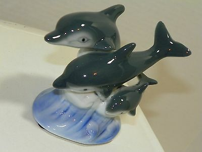Dolphin Family Swimming on Wave Ceramic Figurine