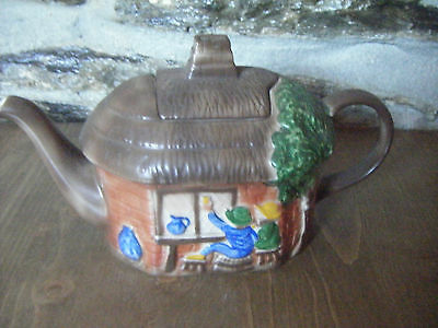 Tony Wood Studio teapot of a thatched roof cottage - 1980's