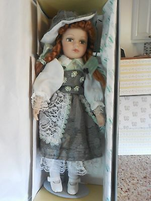 SEYMOUR MANN IVY PORCELAIN DOLL COLLECTION W/STAND