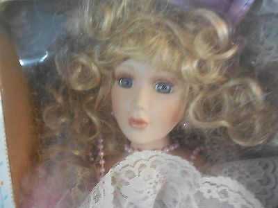 SEYMOUR MANN  PORCELAIN DOLL COLLECTION W/STAND BLONDE W/LAVENDER AND LACE