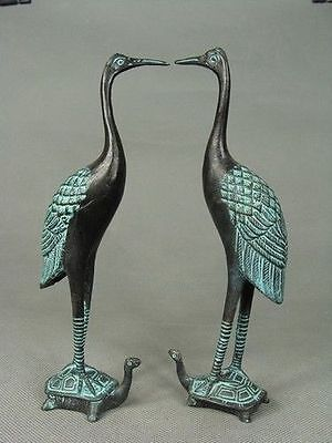 pair of old hand-carved bronze statue cranes