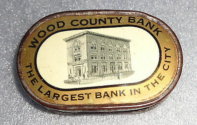 old celluloid dime bank advertising Wood County Bank