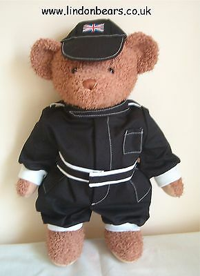 A New Lindon Jointed Bear In A Black With White Trim Formula 1 Style Racing Suit