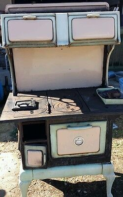 Peggy Wasgington Cute green porcelain cook wood stove, complete