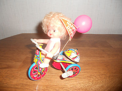 VINTAGE RUBBER DOLL GIRL ON TIN BICYCLE WIND UP TOY HAPPY DAYS W/ BELL MINT