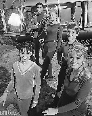 Cast of Lost in Space Posing Near the Chariot