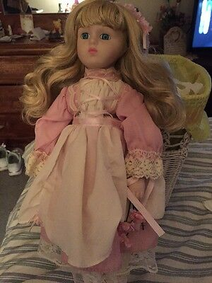 Procelain Doll With Pink And White Dress On Stand
