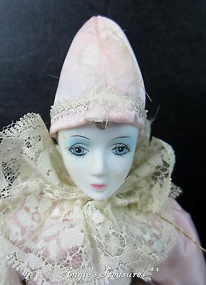 """Vintage 11"""" tall Porcelain Clown with Pink & White Outfit/ White Lace Collar"""