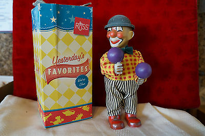 vintage wind-up clown playing the maracas russ toys