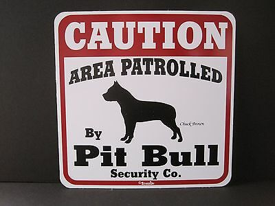 Sign: CAUTION: AREA PATROLLED by Pit Bull Security Co.