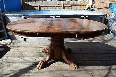 Round Solid Oak Dining Table With one Leave Extension Claw Feet