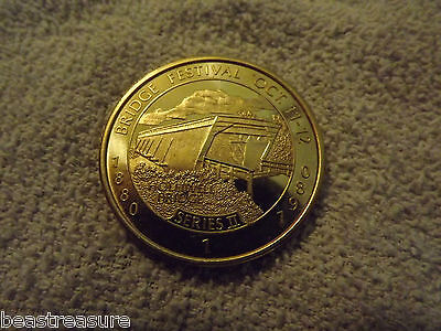 Winterset Iowa , Madison County Bridge Festival Coin 1987 series II hollwell