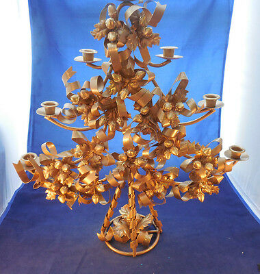 "lg. gold metal Christmas tree shape candleholder about 21 3/4"" wide by 24"" tall"