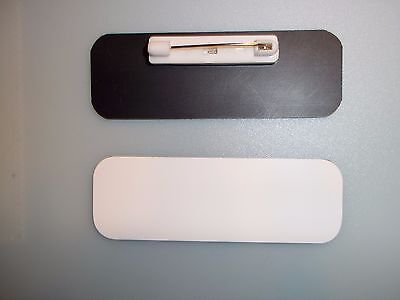 "20 white/black, blank name badges tags 1x3"" with pins and rounded corners."