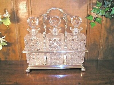 STUNNING silver plate 3 BOTTLE CUT GLASS/CRYSTAL TANTALUS or DECANTER STAND