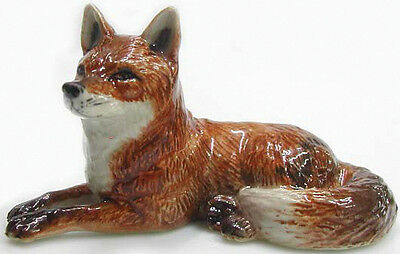R031 - Northern Rose Miniature - Red Fox Lying down