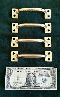 4 matching antique heavy cast brass handles or pulls restored