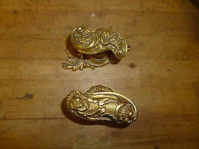 Two Different Ornately Decorated Antique-looking Brass Door Handles