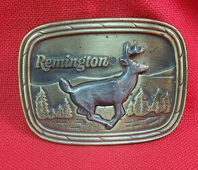 Vintage brass Remington belt buckle running white-tailed deer By Sid Bell 1979