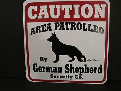 Sign: Caution Area Patrolled By GERMAN SHEPHERD SECURITY CO.