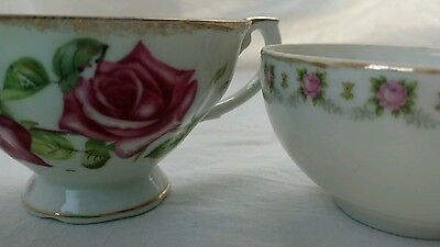 Roses china 2 tea cups and saucers Good condition pink and red