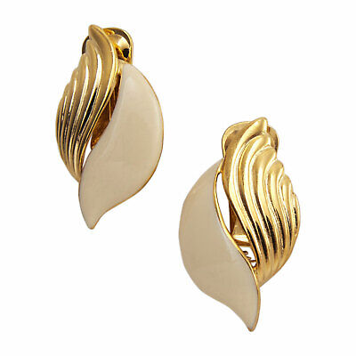 Vintage 1980s Abstract Swirl Gold Tone Off White Enamel Clip On Earrings