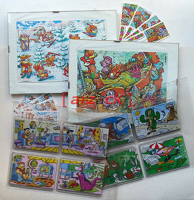 KINDER SORPRESA Puzzle SERIE COMPLETE con cartine custodie e folder LOONEY TUNES