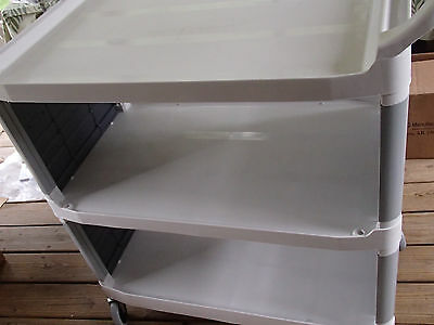Rubbermaid White Xtra Bussing Cart with Enclosed Panels on Both Sides 300 pounds