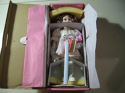 "12"" Paradise Galleries Porcelain Doll, New in Box with stand"