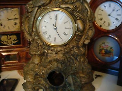 1870's cupid iron front clock 8 day....rare