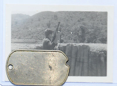 Wartime Picture of a Soldier Holding a Swedish K Machine Gun