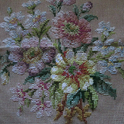 Uncompleted tapestry bouquet of flowers