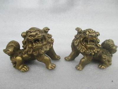 The ancient Chinese sculpture copper pair of lions feng shui kirin dog statues