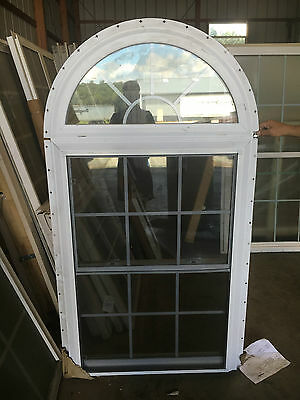 Double hung window with half round