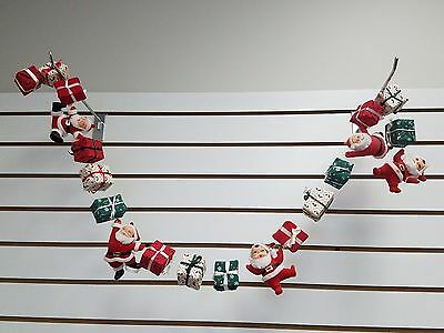 "VTG FLOCKED DANCING SANTAS & CHRISTMAS PRESENTS GARLAND String 48"" long"