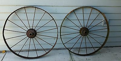 Antique steel wheels from horse drawn dump rake sold separately