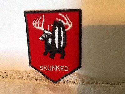"1980's PATCH SKUNKED SKUNK EMBROIDERY  on RED FELT BACKGROUND 4"" x 3"""